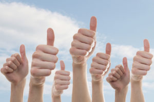 Collection of people showing thumbs up