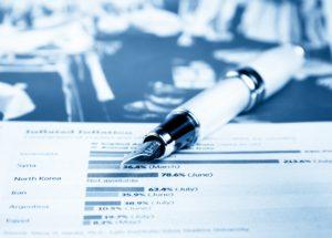 financial chart and graph near business fountain pen