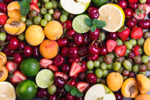 Colorful fruit background. Summer ripe bruits and berries viewed from above